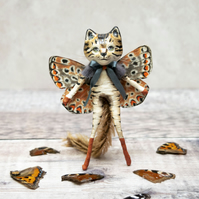 Miniature cat figurine. Quincy the cat butterfly, a luxury art doll