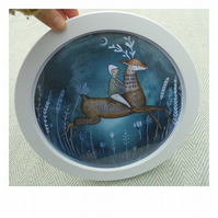 Deer rider print in a round frame