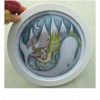 Whale print in a round frame