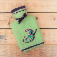 Knitted hot water bottle with needle felted butterfly