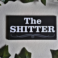 The Shitter stick on door sign. ( bathroom door sign)