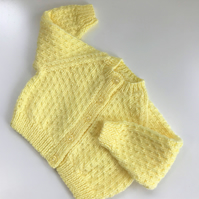 Hand knitted baby cardigan to fit up to 12 months in lemon