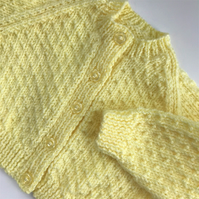 Hand knitted baby cardigan to fit 0-6 months in lemon