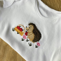 Baby body suit 6 - 9 months with embroidered hedgehog design