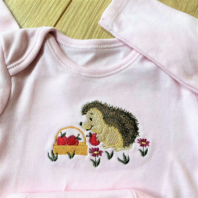Newborn baby bodysuit with machine embroidered hedgehog motif