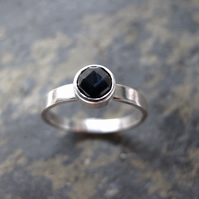 White gold solitaire, black sapphire engagement ring