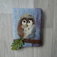 Small felted  picture of an owl sat on a branch