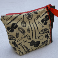 Music Print Zipped Purse. Fully Lined with Gusset and Zip. Ric Rac Trim. Orange.