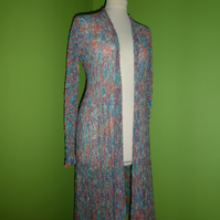 Cardigan in Multicolour Boucle Yarn. Womens approx size 12-14. Flare Top