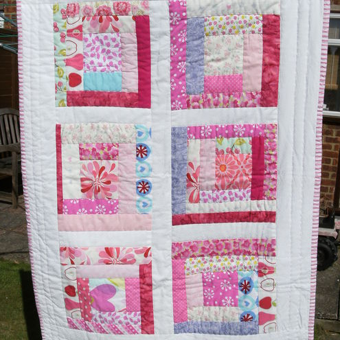 Pink & white baby quilt