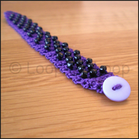 Purple beaded crochet bracelet