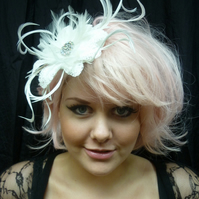 Silk satin ivory fascinator with handmade embroidered flowers & feathers.