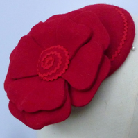 Red felt fascinator with flower