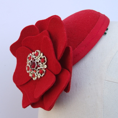 Red felt fascinator with flower and vintage brooch.