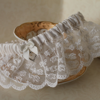 Vintage lace wedding garter with Diamante heart and bow