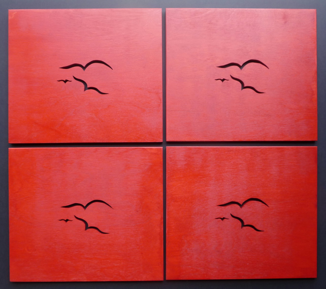 Set of 4 red Seagull placemats.