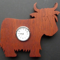 Heilin coo Shaped clock