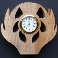 Shaped thistle clock