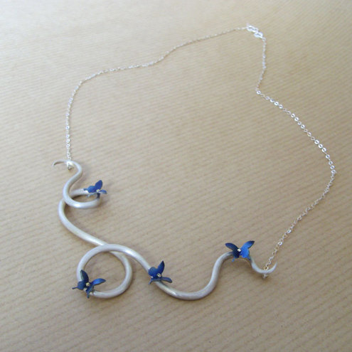 titanium butterflies and silver vine necklace.