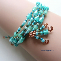 Sea foam green and copper memory wire bracelet