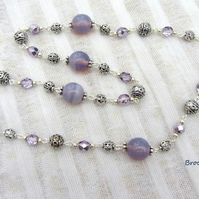Hand wired necklace with mauve glass and silver beads