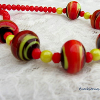 Red swirly lampwork glass necklace with sterling silver fastening