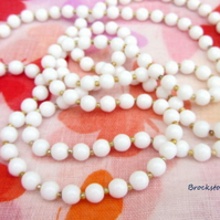SALE   Long white beaded necklace 40 inches