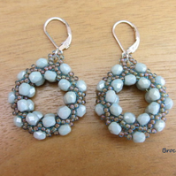 Beadwoven hoop earrings with sterling silver ear fitting