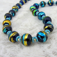 Navy blue gold and turquoise beaded necklace