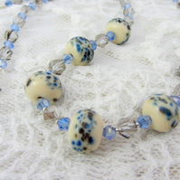 Lampwork glass necklace in blue and cream