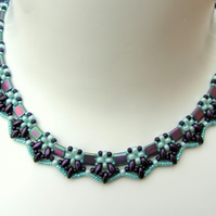 Egyptian collar necklace in aubergine and aquamarine