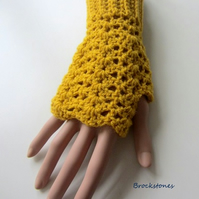 Fingerless texting mittens crocheted in mustard yarn