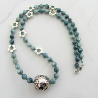 Daisy ball necklace with teal coloured Mother of Pearl