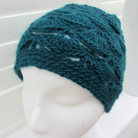 Crocheted cloche hat in teal green
