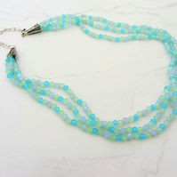 Three strand crystal necklace in blue green and turquoise