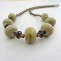 Lampwork necklace in neutral tones with Smoky Quartz