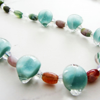 Glass teardrop necklace in pale turquoise with colourful agates