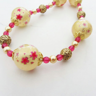 Necklace - gold pink and white with flowery decal beads