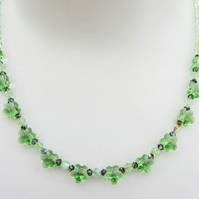 Glass necklace with Swarovski crystals in Peridot green
