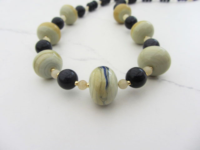 Artglass necklace in beige, mustard and blue