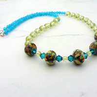 Lampwork glass necklace in shades of yellows and blues