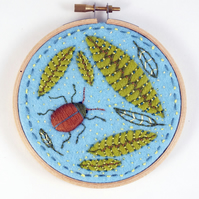 Embroidery Hoop  applique and embroidery on felt, beetle and leaves