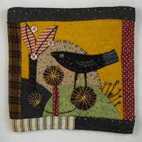 Folk art applique,patchwork,embroidery framed bird picture