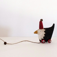 Little Primitive painted Fabric Hen on Wheels