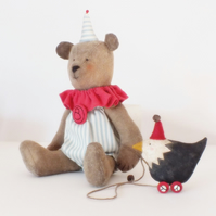 Primitive dressed bear and chicken