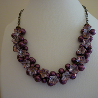 WINE AND ANTIQUE GOLD CLUSTER NECKLACE.  459