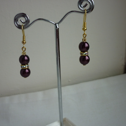 AUBERGINE AND GOLD PLATED RHINESTONE RONDELLE EARRINGS.  376