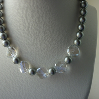 MATT SILVER GREY AND FACETED CRYSTAL NECKLACE.  629