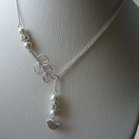 RHINESTONE AND IVORY, BIRD AND LEAF LARIAT DESIGN NECKLACE.  795