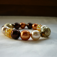 BROWN, COPPER AND GOLD BRACELET.  813